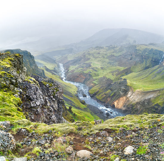Small Icelandic stream in a foggy day. View from the top of a rocky mountain. Beauty In Nature Cliff Day Fog Landscape Mountain Mountain Range Nature No People Outdoors Rock - Object Scenics Sky Tranquil Scene Tranquility Water Waterfall