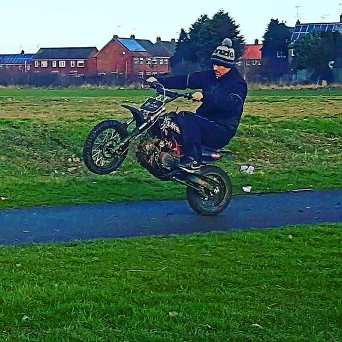 Wheels in motion Outdoors Stunt Grass One Person Adult Showingoff Check This Out Best Of EyeEm Hull City Of Culture 2017 Adventure Club Grass Green Color Sport