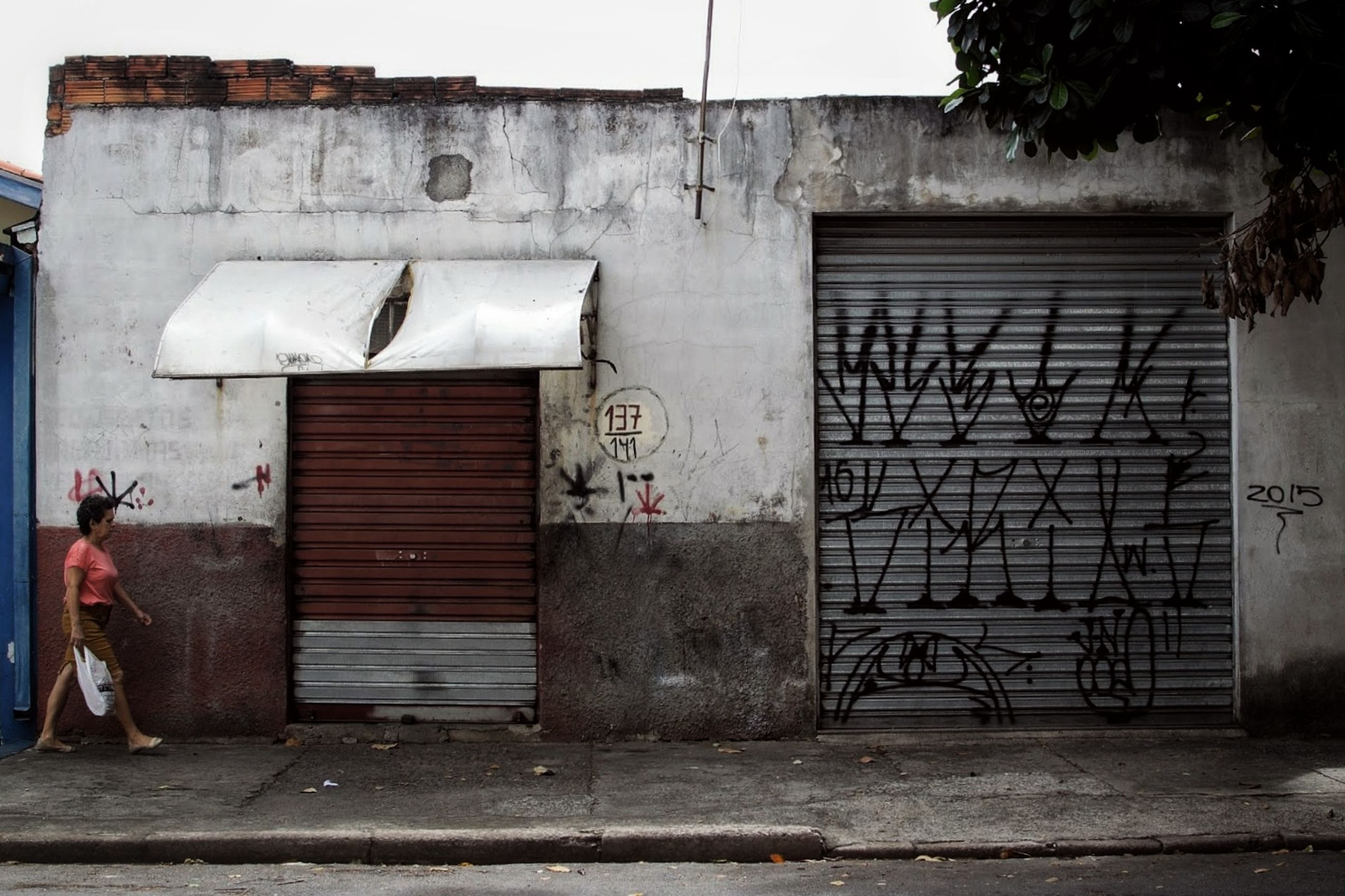 architecture, building exterior, built structure, day, closed, building, no people, graffiti, entrance, door, outdoors, wall - building feature, wall, city, old, corrugated iron, abandoned, gate, window, house, iron, garage