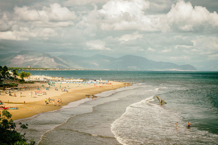 Beach Calm City City Life Cloud - Sky Coastline Enjoyment High Angle View Mountain Mountain Range Ocean Sand Scenics Sea Shore Sky Tourism Tourist Tranquil Scene Tranquility Travel Destinations Vacations Water Waterfront Weekend Activities
