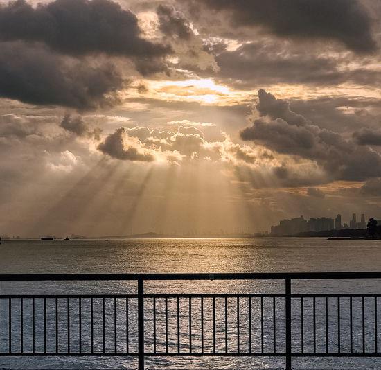 Sunset ray Singapore Beach Beauty In Nature Bedok Jetty Cloud - Sky Horizon Horizon Over Water Idyllic Jetty Nature No People Outdoors Railing Scenics - Nature Sea Sky Streaming Sun Sunbeam Sunlight Sunset Tranquil Scene Water