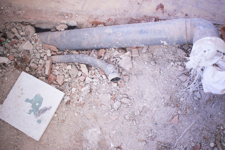 High angle view of abandoned pipe