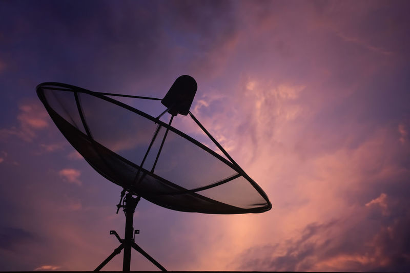 Silhouette satellite dish against sky during sunset
