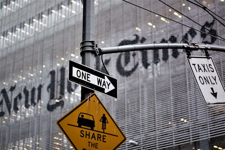 NYC The New York Times Text Communication Sign Western Script Guidance Symbol Information Architecture No People Information Sign Arrow Symbol Directional Sign Warning Sign Road Sign Building Exterior Built Structure Non-western Script Low Angle View Capital Letter Day