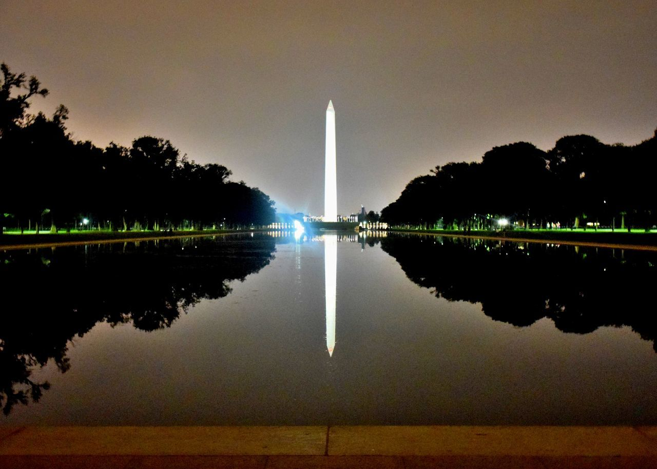 reflection, water, tree, travel destinations, built structure, architecture, tourism, symmetry, sky, nature, reflecting pool, outdoors, travel, history, night, no people, lake, illuminated, beauty in nature, scenics, city