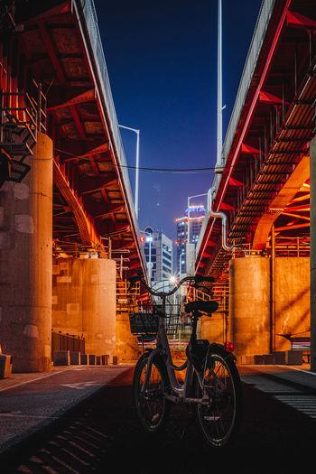 View of bridge in city against sky at night