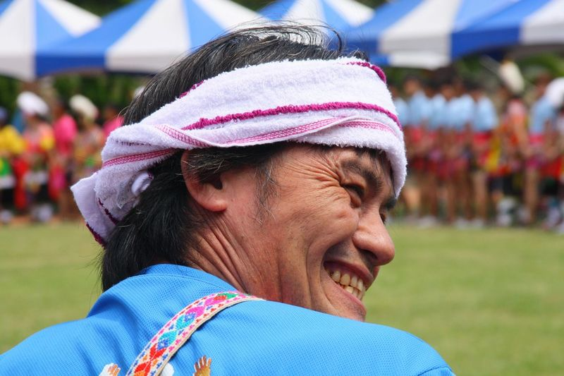 Close-Up Of Happy Man During Traditional Dance Festival
