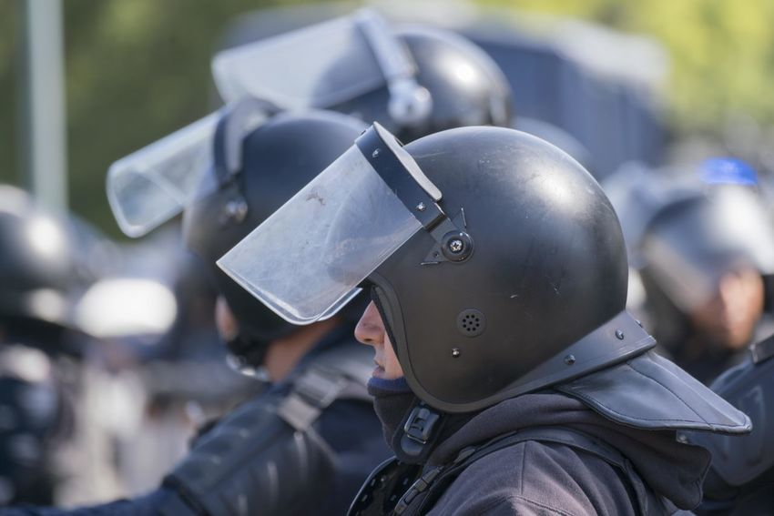 Anti-riot police remain standing during an operation. Anti-riot Police Aggression  Clothing Day Focus On Foreground Government Group Of People Headshot Headwear Helmet Incidental People Law Men Military Outdoors People Police Force Portrait Protection Real People Riot Police Safety Security Uniform