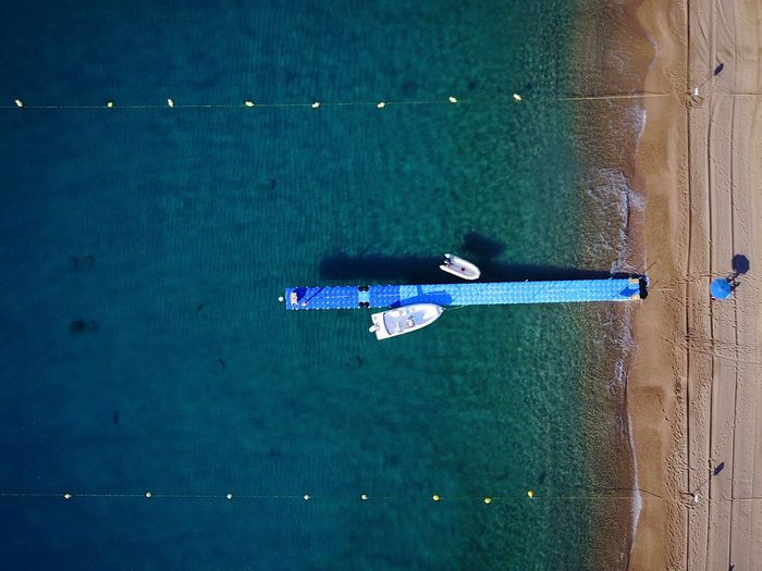 Aerial View Of Jetty On Sea
