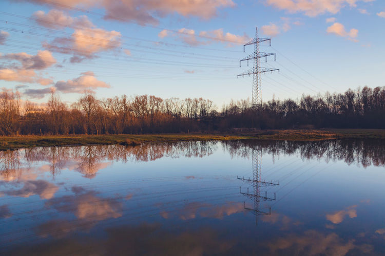 Reflection Technology Sky Electricity  Electricity Pylon Cloud - Sky Water Lake Power Supply Power Line  Cable Connection Tranquility Nature Beauty In Nature Fuel And Power Generation Tranquil Scene No People Tree Outdoors Electrical Equipment