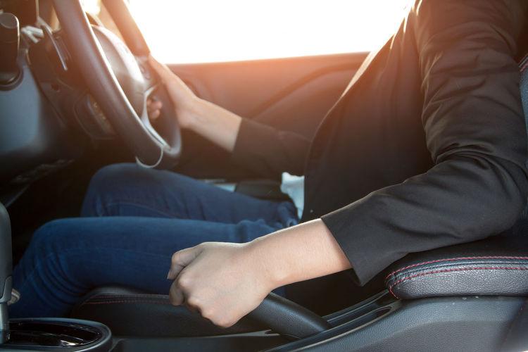 Close-up of woman driving car