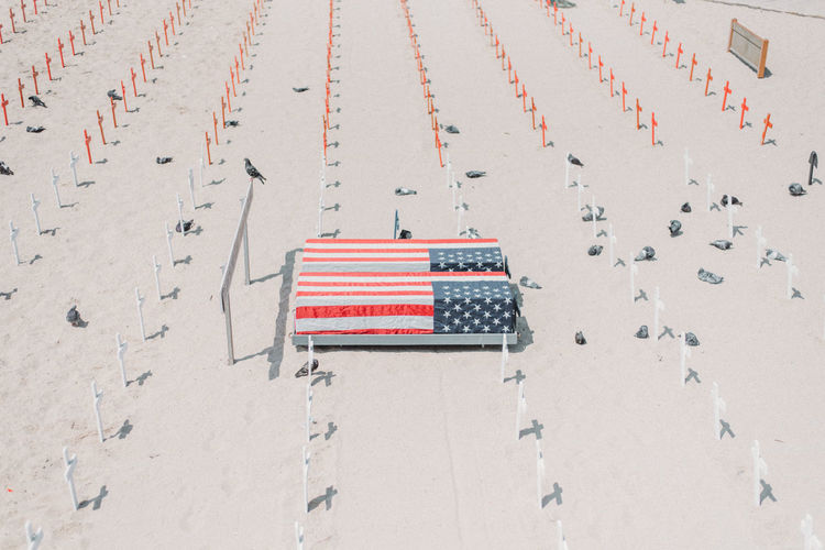 High angle view of flag on sand