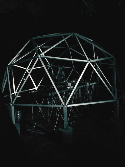 Low angle view of illuminated built structure at night