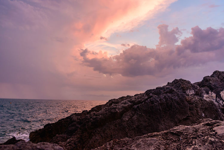 Atmospheric Mood Beauty In Nature Cliff Cloud - Sky Dramatic Sky Geology Horizon Over Water Majestic Nature Non-urban Scene Outdoors Physical Geography Remote Rock - Object Rock Formation Scenics Sea Seascape Shore Sky Tourism Tranquil Scene Tranquility Vacations Water