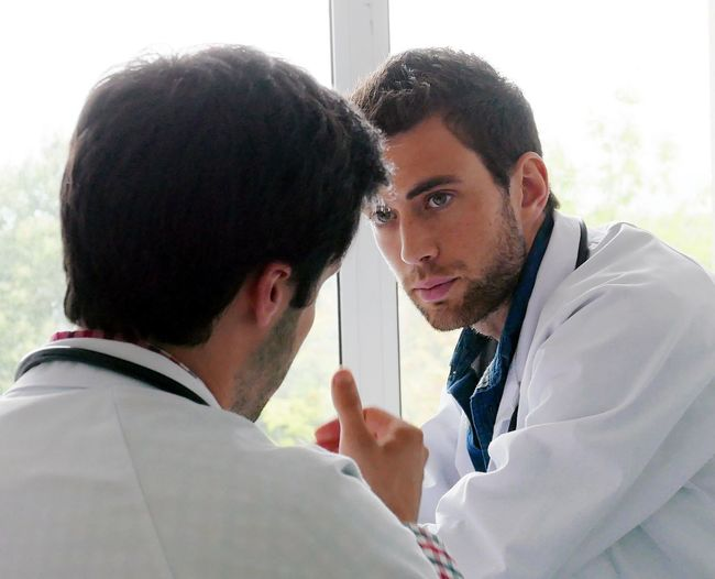 Doctors Discussing In Hospital