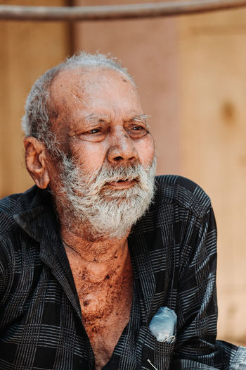 Facial Hair Senior Adult Males  Beard One Person Real People Senior Men Men Adult Headshot Portrait Lifestyles Front View Gray Hair Mature Adult Mature Men Indoors  White Hair Focus On Foreground Mustache Contemplation The Photojournalist - 2019 EyeEm Awards The Portraitist - 2019 EyeEm Awards