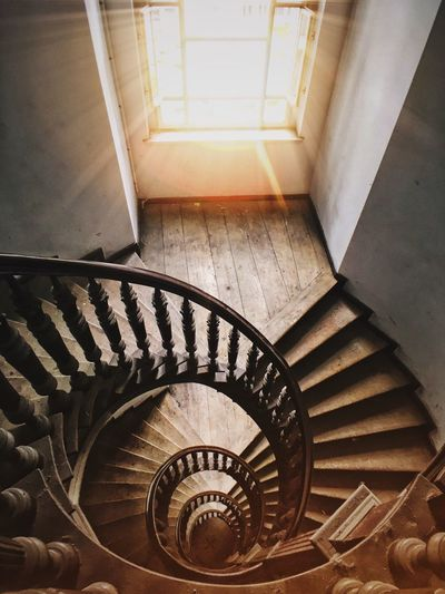 High Angle View Of Empty Spiral Staircase In Building