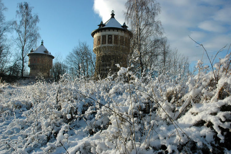 Frost Architecture Bare Tree Building Exterior Built Structure Cold Temperature Field Gas Tower Nature No People Outdoors Riga Round Building Snow Tower Tree Weather Winter