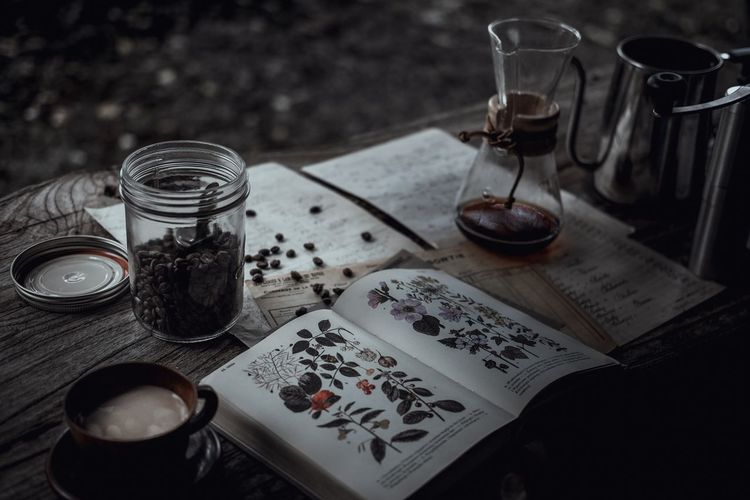 Outdoors Coffee High Angle View Text Indoors  Container Glass Drink Group Of Objects Food And Drink Book