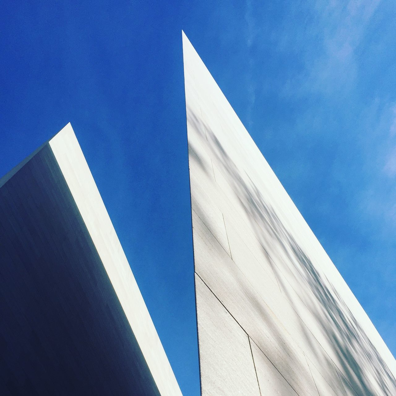 low angle view, built structure, architecture, blue, building exterior, day, no people, modern, outdoors, sky, clear sky