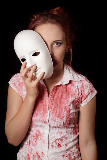 halloween costume BLOODY Cosplay Halloween Horror Zombie Adult Black Background Blood Costume Looking At Camera Mask - Disguise People Portrait Real People Redhead Studio Shot Vampire Young Adult Young Women