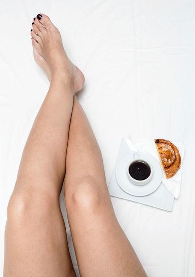 Adult barefoot Beautiful Woman Body Part Directly Above Domestic Room Food And Drink High Angle View Human Body Part Human Foot Human Leg Human Limb Indoors  Legs Crossed At Ankle Lifestyles Low Section Nail One Person Personal Perspective Real People Relaxation Tiled Floor Women