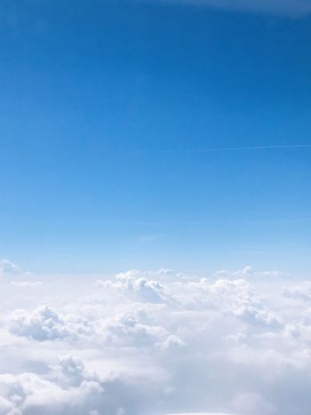 Sky Blue Cloud - Sky Beauty In Nature Tranquility Nature No People Low Angle View Cloudscape Backgrounds Tranquil Scene Heaven Sunlight Outdoors Scenics - Nature Idyllic Copy Space Day White Color Fluffy