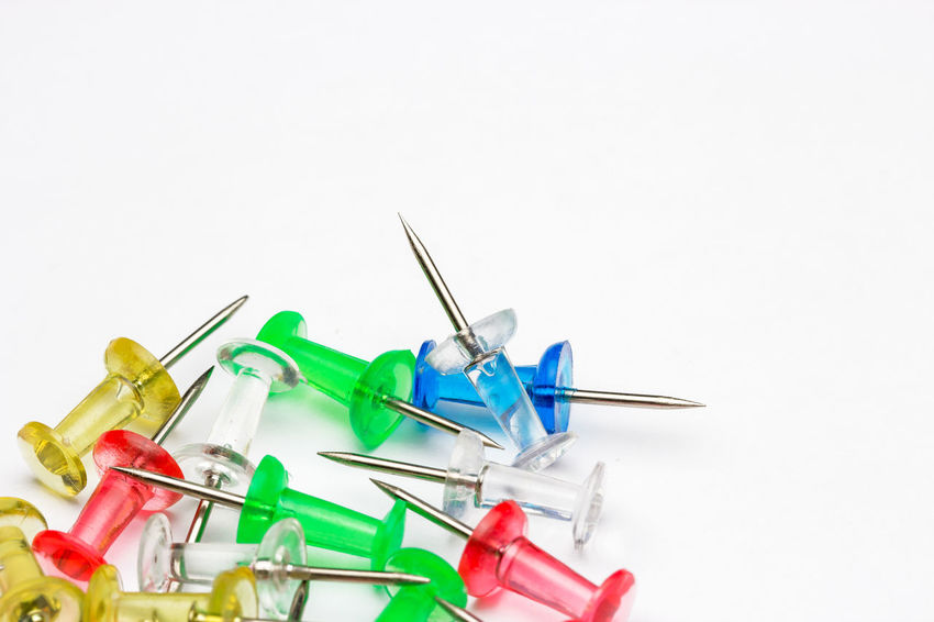 push pin needle on white background Office Close-up Day Indoors  Large Group Of Objects Needle No People Plastic Push Pins Studio Shot White Background Word Space