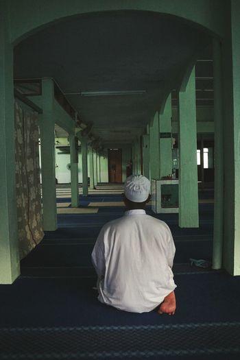 Rear view of woman walking in corridor