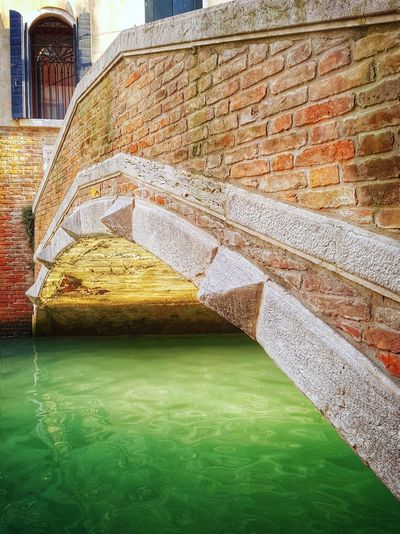streets of Venice Canal Water Water Reflections Architecture Architectural Feature Arch Bridge Architecture Details Bridge - Man Made Structure Bridge Bridges Brick Wall Brick Under The Bridge Under Venice Venice, Italy Venezia Veneto Italy City Architecture Building Exterior Built Structure Green Color Footbridge Architectural Detail Architecture And Art