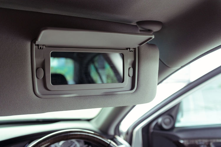 Close-up of mirror in car