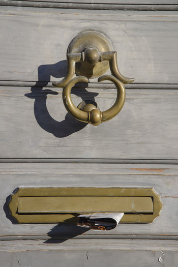 Close-up of door handle on table