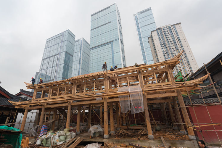 works in the central city in chengdu Architecture Building Building Exterior Built Structure City Cloud - Sky Construction Equipment Construction Industry Construction Site Day Demolished Development Incomplete Industry Low Angle View Modern Nature No People Office Building Exterior Outdoors Sky Skyscraper Tall - High