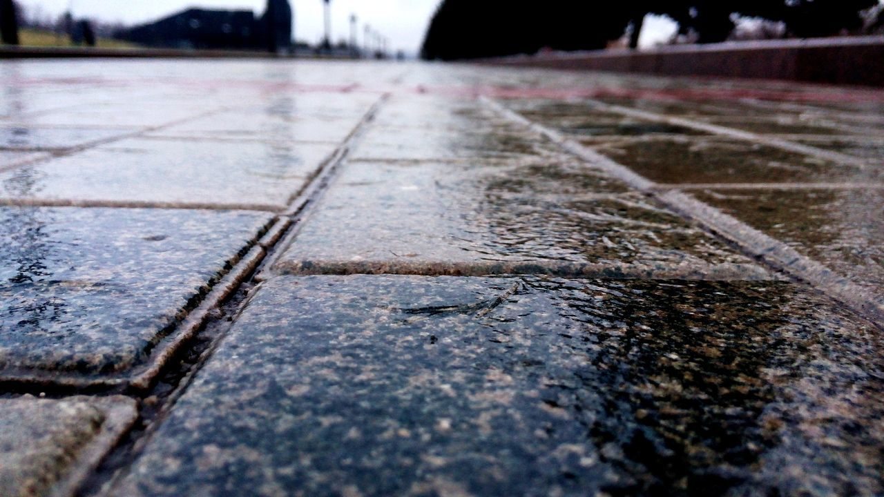 surface level, close-up, no people, day, road, transportation, outdoors, water, nature