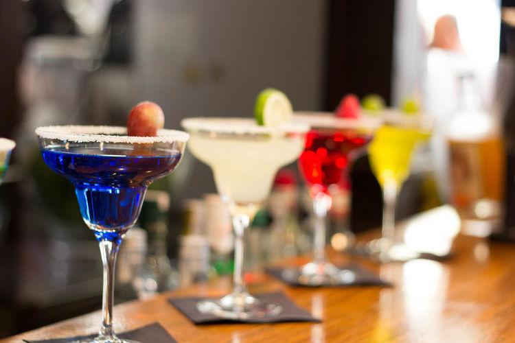 Close-up of colorful cocktails on counter