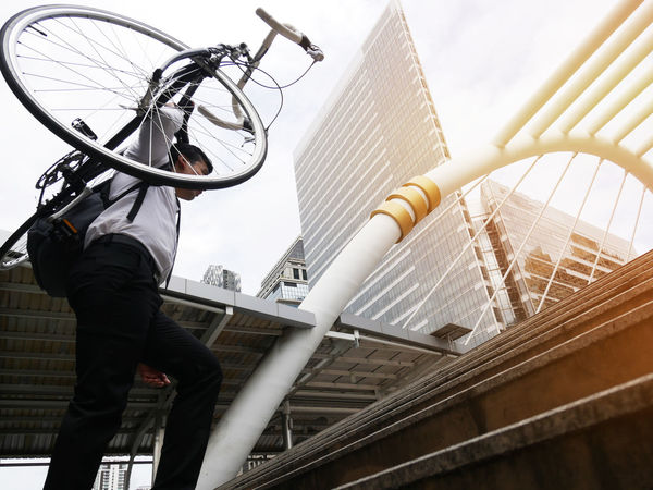 Business man riding bicycle go to worker. Architecture Bicycle Bridge Bridge - Man Made Structure Building Building Exterior Built Structure City Day Leisure Activity Lifestyles Low Angle View Men Nature Office Building Exterior One Person Outdoors Real People Sky Skyscraper Three Quarter Length Transportation