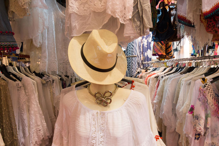 Boutique Bridal Shop Choice Choosing Clothing Clothing Store Coathanger Consumerism Customer  Day Fashion For Sale Hanging Hat Indoors  Large Group Of Objects Mannequin People Retail  Store Textile Textile Industry Variation