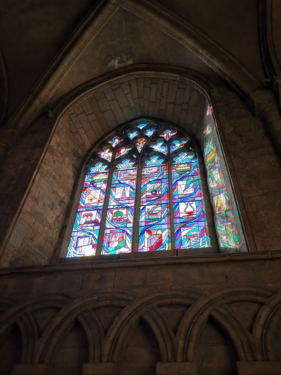 place of worship, built structure, religion, stained glass, spirituality, belief, architecture, window, glass, building, low angle view, glass - material, no people, arch, multi colored, indoors, ornate, ceiling, floral pattern, architecture and art