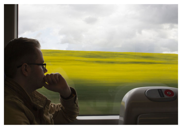 Portrait of man driving car against sky