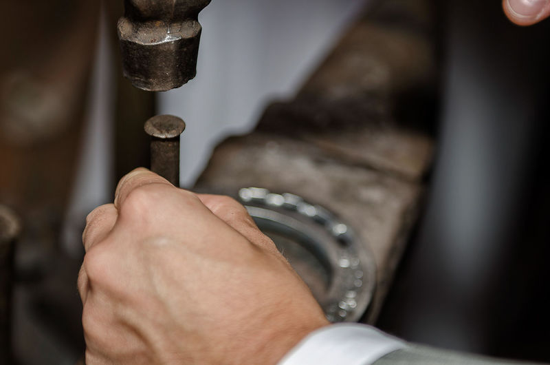 Close-up of man working at workshop