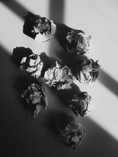High Angle View Of Crumpled Papers On Table With Sunlight