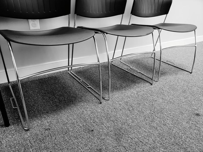 Empty chairs on carpet