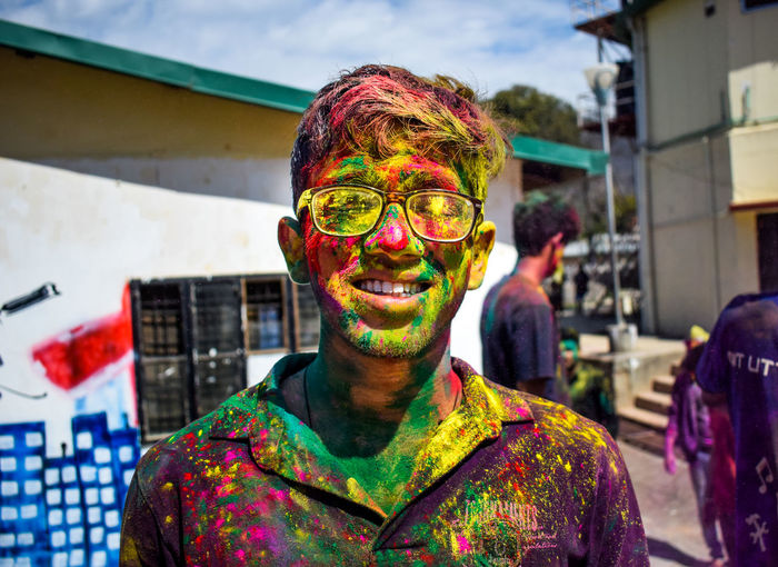 EmNewHere Multi Colored Holi Face Paint Individuality One Man Only Headshot Mid Adult Celebration Adult One Person Front View Only Men Mid Adult Men Fun Adults Only Happiness Focus On Foreground Portrait People Traditional Festival Fresh On Market 2017