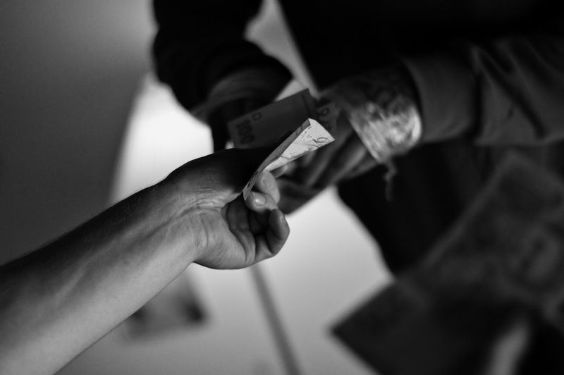 Close-up of hand holding money