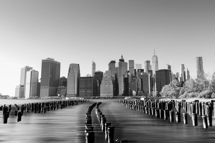 Long exposure Manhattan skyline from Brooklyn waterfront in black and white. Ice Manhattan Skyline Weather Winter Architecture Black And White Building Exterior Built Structure City Cityscape Clear Sky Crisp Day Long Exposure Modern No People Outdoors Sky Skyscraper Terrorism Travel Destinations Urban Skyline Water Waterfront