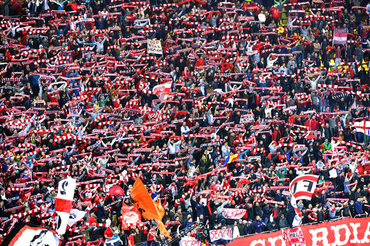 Football fans of Dinamo Bucharest during a match against Steaua Bucharest, in the National Arena stadium, final score: 1-1. On April 17, 2014 in Bucharest, Romania Dinamo Bucharest Football Football Fever Hooligans Steaua Bucharest Supporters Supporting My Team Abundance Crowd Crowd Of People Crowded Fan - Enthusiast Flag Football Stadium High Angle View Large Group Of People Patriotism People Real People Red Soccer Spectator Stadium Togetherness Unity