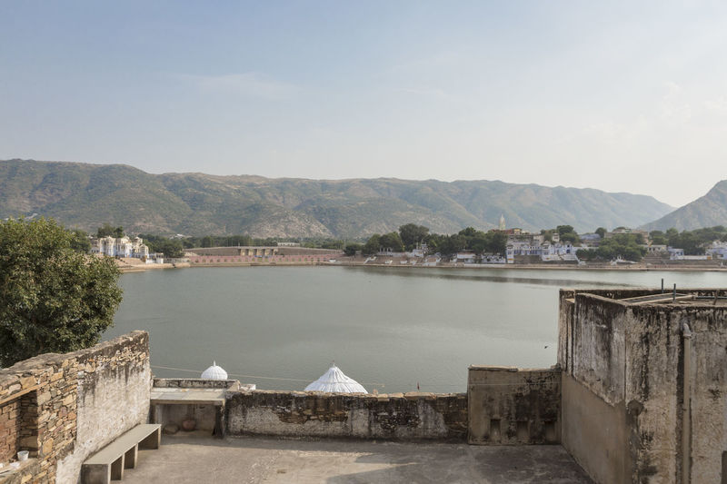 view of Pushkar lake from building deck in afternoon time, Rajasthan, India Architecture Beauty In Nature Built Structure Day India Indiapictures Lake Mountain Mountain Range No People Outdoors Pond Pushkar Residential District Residential Structure Scenics Town Tranquil Scene Tranquility Travel Destinations Travel Photography