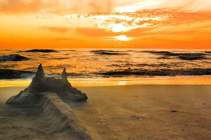 Castle of summer. Eyemphotography Fotoalibi Nida Lithuania Lithuania Castle Sunset Orange Color Sky Sea Beauty In Nature Scenics Nature Beach Cloud - Sky Tranquil Scene Sun Water Horizon Over Water Outdoors No People Sand