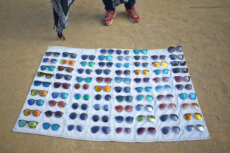 Street Vendor Choice High Angle View Human Body Part Human Foot In A Row Multi Colored Order Sunglasses Variation