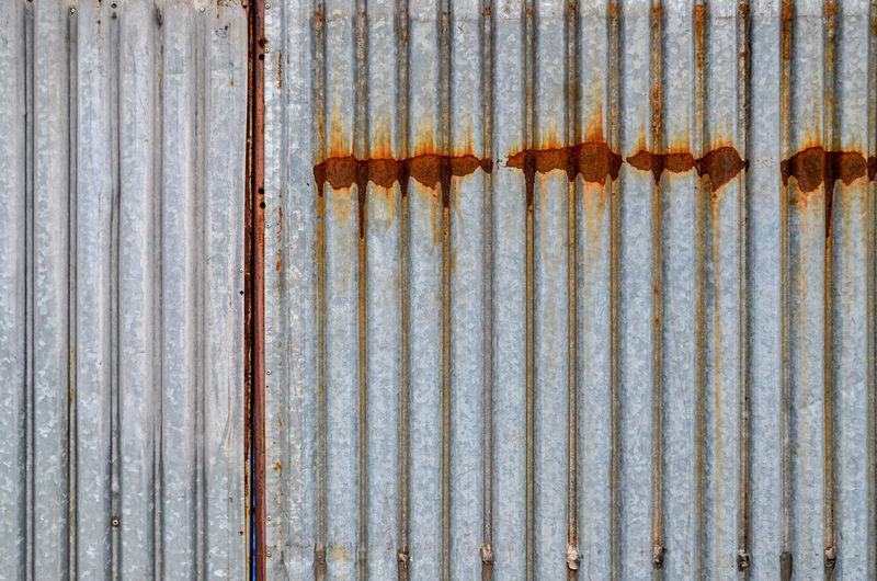 Full frame shot of rusty silver metallic wall